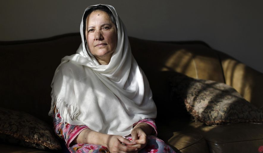 Shamim Syed, whose son Adnan was convicted for the 1999 murder of his ex-girlfriend and whose case is being revived in a wildly popular podcast, poses for a photograph in her home, Wednesday, Dec. 10, 2014, in Baltimore. A Maryland appeals court recently showed interest in the case and will hold a hearing in January weighing arguments that the man had ineffective counsel. (AP Photo/Patrick Semansky)
