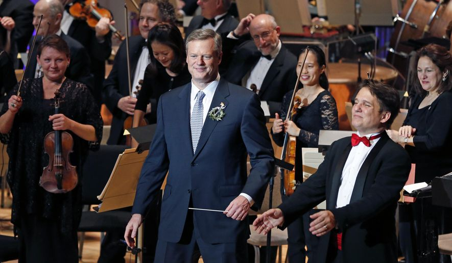 "Guest conductor, Mass. Governor-elect Charlie Baker, left, takes in the applause from the audience with Boston Pops Conductor Keith Lockhart, right, after conducting the Boston Pops Orchestra in ""Sleigh Ride"" during the 31st annual ""A Company Christmas at Pops"" at Symphony Hall in Boston, Wednesday, Dec. 10, 2014. (AP Photo/Elise Amendola)"