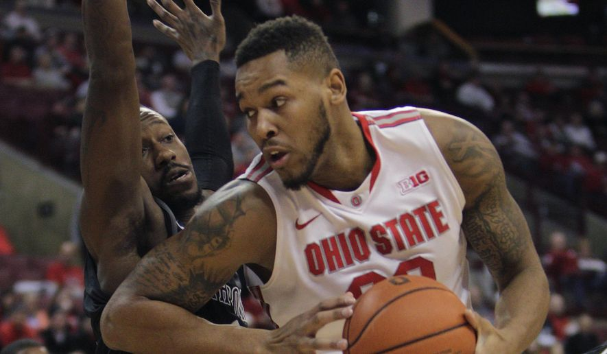Ohio State's Amir Williams, right, posts up against High Point's John Brown during the first half of an NCAA college basketball game Wednesday, Dec. 10, 2014, in Columbus, Ohio. (AP Photo/Jay LaPrete)