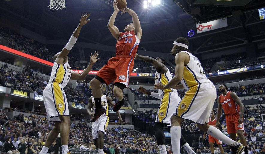 Los Angeles Clippers' Blake Griffin (32) puts up a shot during the first half of an NBA basketball game against the Indiana Pacers Wednesday, Dec. 10, 2014, in Indianapolis. (AP Photo/Darron Cummings)
