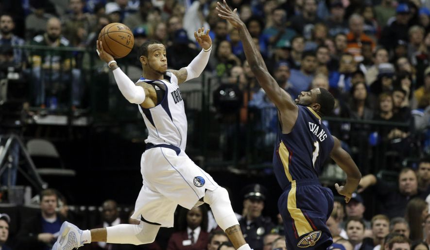 Dallas Mavericks guard Monta Ellis, left, looks to pass off the ball against New Orleans Pelicans forward Tyreke Evans (1) during the second half of an NBA basketball game Wednesday, Dec. 10, 2014, in Dallas.  The Mavericks won 112-107. (AP Photo/LM Otero)