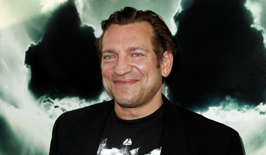 "In this May 23, 2012, file photo, cast member Dimitri Diatchenko arrives at the premiere of ""Chernobyl Diaries"" in Los Angeles. Diatchenko is charged with killing his ex-girlfriend's pet rabbit, sending her grisly photos of its carcass, and threatening to do the same thing to her. (Photo by Matt Sayles/Invision, File)"