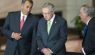 House Speaker John Boehner of Ohio, left, talks with Senate Majority Leader Sen. Harry Reid of Nev., center, and Senate Minority Leader Sen. Mitch McConnell of Ky., on Capitol Hill in Washington, Wednesday, Dec. 10, 2014, during a ceremony to present the Congressional Gold Medal to members of the Civil Air Patrol whose valor and dedication saved countless lives during World War II. (AP Photo/Evan Vucci)