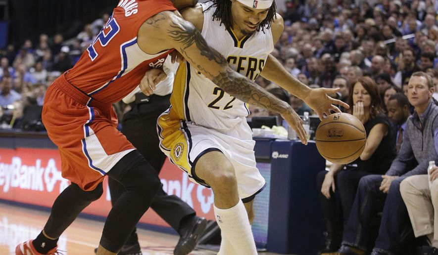 Indiana Pacers' Chris Copeland (22) is defended by Los Angeles Clippers' Matt Barnes (22) during the second half of an NBA basketball game Wednesday, Dec. 10, 2014, in Indianapolis. The Clippers won 103-96. (AP Photo/Darron Cummings)