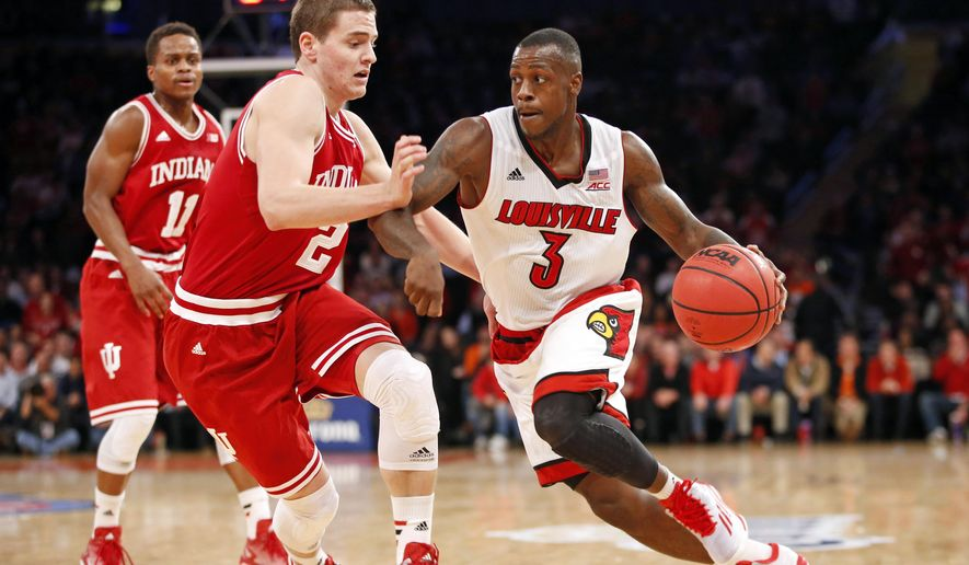 Louisville guard Chris Jones (3) drives around Indiana guard Nick Zeisloft (2) in the first half of an NCAA college basketball game at Madison Square Garden in New York, Tuesday, Dec. 9, 2014. (AP Photo/Kathy Willens)