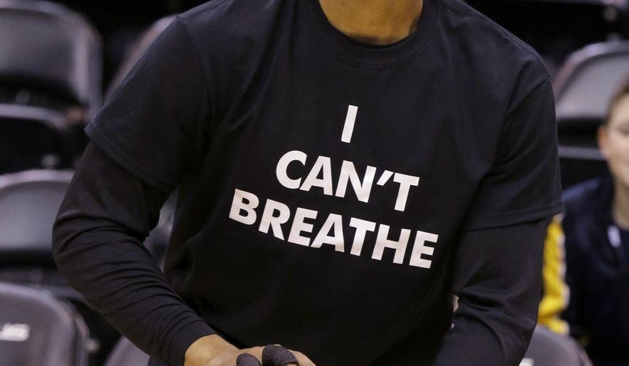 "Portland Trail Blazers guard Damian Lillard wears an ""I Can't Breathe"" shirt before an NBA basketball game against the Minnesota Timberwolves in Minneapolis, Wednesday, Dec. 10, 2014.  (AP Photo/Ann Heisenfelt)"