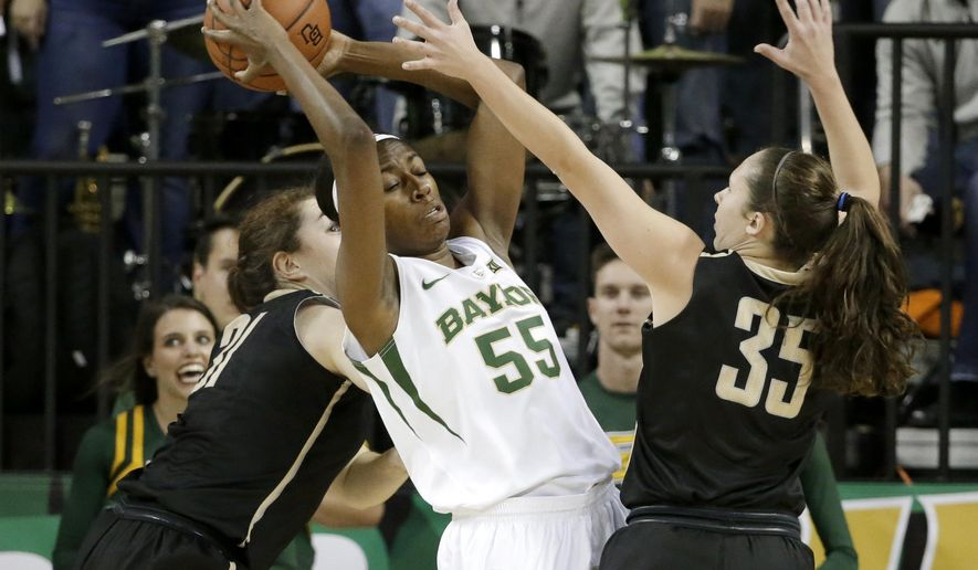 Baylor center Khadijiah Cave (55) grabs a rebound between Idaho's Geraldine McCorkell, left, and Connie Ballestero (35) during the first half of an NCAA college basketball game, Wednesday, Dec. 10, 2014, in Waco, Texas. (AP Photo/Tony Gutierrez)
