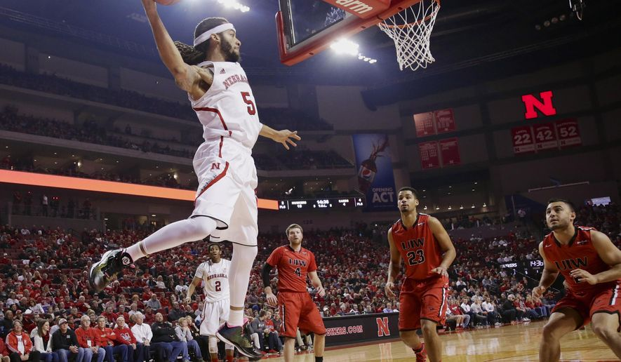 Nebraska's Terran Petteway (5) saves a ball from going out of bounds against Incarnate Word's Kyle Hittle (4), Austin Henry (23) and Mitchell Badillo (2), during the first half of an NCAA college basketball game in Lincoln, Neb., Wednesday, Dec. 10, 2014. (AP Photo/Nati Harnik)