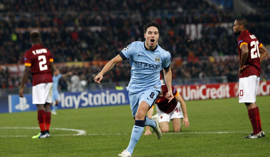 Manchester City's Samir Nasri celebrates after scoring  during a Group E Champions League soccer match between Roma and Manchester City at the Olympic stadium in Rome, Italy, Wednesday Dec.10, 2014. (AP Photo/Riccardo De Luca)