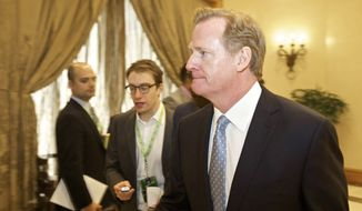 NFL commissioner Roger Goodell attends an owners meeting, Wednesday, Dec. 10, 2014, in Irving, Texas. NFL owners are set to discuss potential changes to the league's personal conduct policy in their final scheduled meeting before the end of the season. (AP Photo/Brandon Wade)