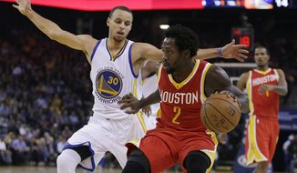 Houston Rockets' Patrick Beverley (2) drives the ball against Golden State Warriors' Stephen Curry, left, during the first half of an NBA basketball game Wednesday, Dec. 10, 2014, in Oakland, Calif. (AP Photo/Ben Margot)