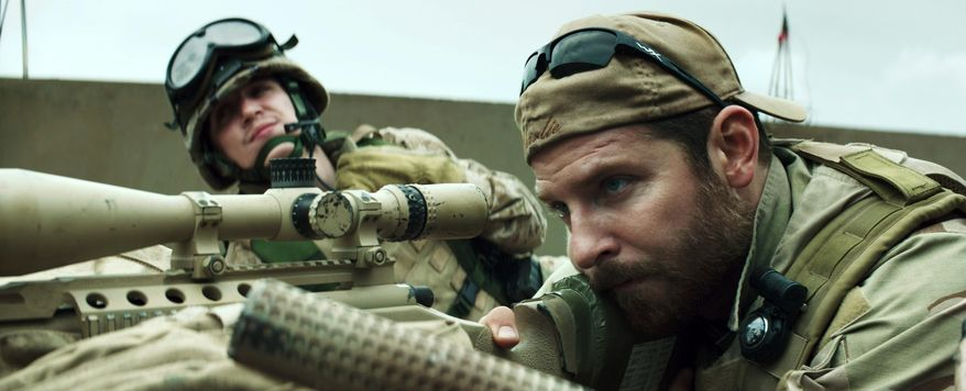 """In this image released by Warner Bros. Pictures, Kyle Gallner, left, and Bradley Cooper appear in a scene from """"American Sniper.""""  The film, directed by Clint Eastwood, did not receive any Golden Globe nominations on Thursday.  (AP Photo/Warner Bros. Pictures)"""