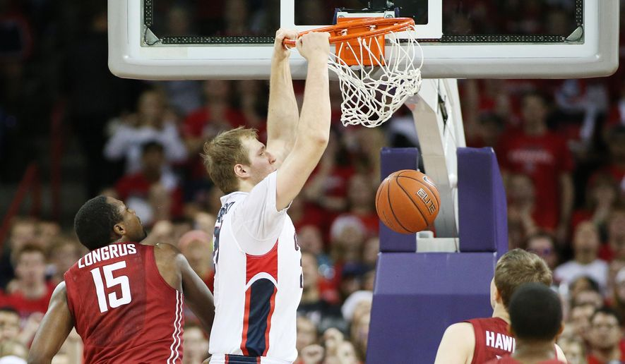 Gonzaga's Przemek Karnowski dunks against Washington State during the first half of an NCAA college basketball game in Spokane, Wash., Wednesday, Dec. 10, 2014. (AP Photo/Young Kwak)
