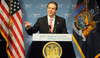 Gov. Andrew Cuomo speaks during the  Regional Economic Development Council Awards  on Thursday Dec. 11, 2014 in Albany, N.Y.   The Cuomo administration has awarded a new round of grants and tax credits to companies worth an estimated $709 million for 852 projects expected to create jobs.  (AP Photo/Times Union, Michael P. Farrell)   TROY, SCHENECTADY; SARATOGA SPRINGS; ALBANY OUT