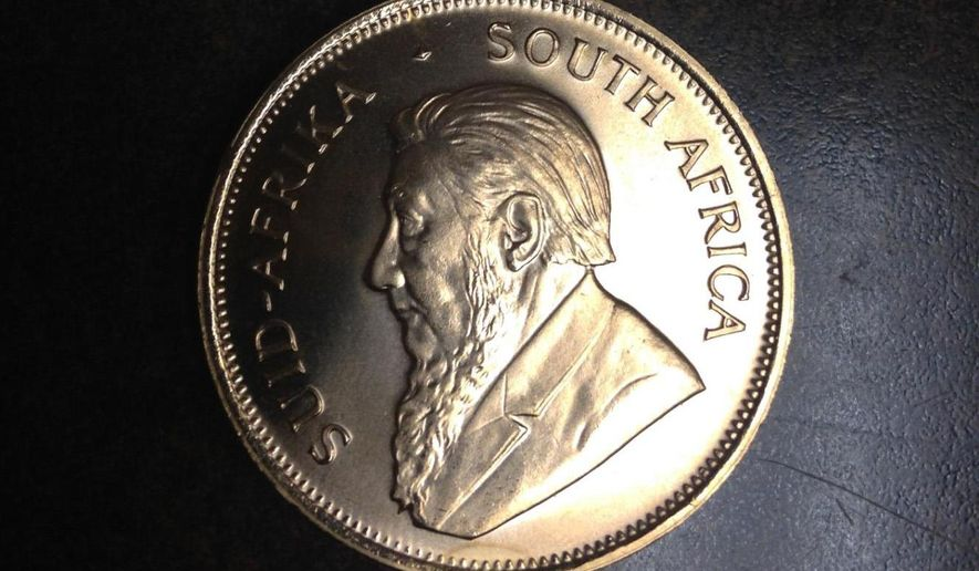 This undated photo provided by the Salvation Army on Wednesday, Dec. 10, 2014 shows a South African Krugerrand which was found in one of the donation kettles at a supermarket in Bay City, Mich. on Friday, Dec. 5, 2014. The 1984 gold coin has an estimated value of $1,200. In 2013, an anonymous donor donated a similar coin at a red kettle location at a drug store in Bangor Township, near Bay City. (AP Photo/Salvation Army)