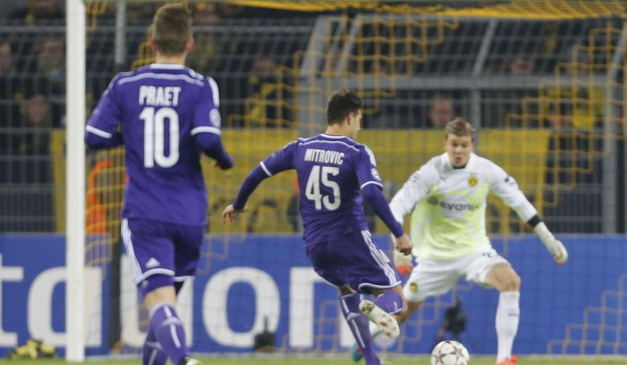 Anderlecht's Aleksandar Mitrovic fails to score as he faces Dortmund's goalkeeper Mitchell Langerak during the Group D Champions League soccer match between Dortmund and Anderlecht in Dortmund, Germany, Tuesday Dec. 9, 2014. (AP Photo/Frank Augstein)