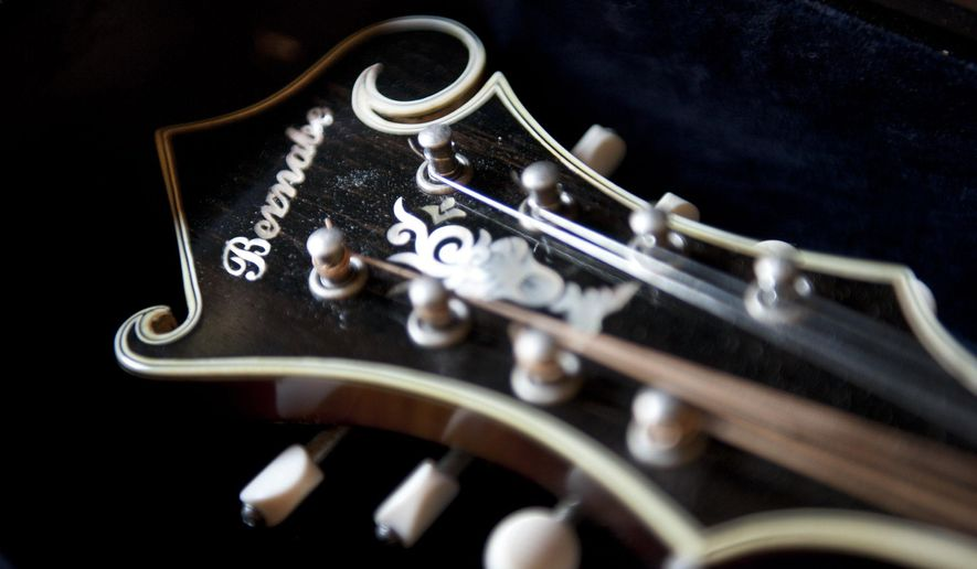 ADVANCE FOR USE MONDAY, DEC. 15, 2014, AND THEREAFTER- This photo taken on Sept. 2, 2014, shows the mother of pearl inlay on the headstock of James Bernabe's older mandolins at his workshop in Winston-Salem, N.C. Bernabe began making mandolins in the 1990s and now makes 6-8 instruments a year. (AP Photo/The Winston-Salem Journal, Walt Unks)
