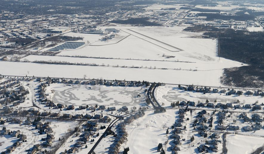 A Feb. 6, 2013 aerial photo shows the Ann Arbor Municipal Airport and landing strip looking east over Lohr Road in Pittsfield Township, Mich. Ann Arbor and DTE Energy Co. are making plans for a large solar farm at Ann Arbor Municipal Airport. The Ann Arbor News reports that city officials announced details of the roughly 10-acre, 1-megawatt solar farm that could be expanded in the future. (AP Photo/The Ann Arbor News, Melanie Maxwell)