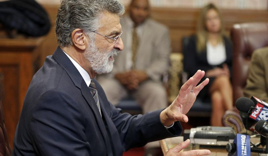 Cleveland Mayor Frank Jackson discusses a U.S. Justice Department report on the city's police department during a news conference in Cleveland Thursday, Dec. 11, 2014. The report  strongly criticized the police department for a pattern and practice of using excessive force and violating people's civil rights. (AP Photo/Mark Duncan)