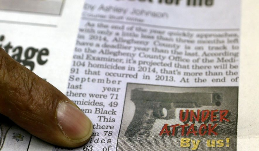 ADVANCE FOR USE MONDAY, DEC. 15, 2014, AND THEREAFTER- In this Nov. 20, 2014, photo, New Pittsburgh Courier editor and publisher Rod Doss, points out the graphic the paper is using in recent articles focused on black on black violent crime while in the newspaper conference room in Pittsburgh. The Courier, an historic black newspaper, began a campaign with coverage of each homicide almost a decade ago because editors at the Courier simply felt black-on-black killings were not getting the attention they deserved. (AP Photo/Keith Srakocic)