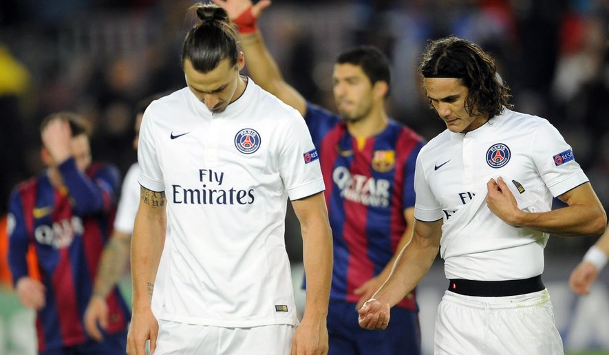 PSG players,  Zlatan Ibrahimovic and Edinson Cavani, right, leave the pitch at the end of the Group F Champions League soccer match between FC Barcelona and PSG at the Camp Nou stadium in Barcelona, Spain, Wednesday Dec. 10, 2014. Lionel Messi, Neymar and Luis Suarez all scored to lead Barcelona to a thrilling 3-1 comeback win over Paris Saint-Germain on Wednesday, as the Spanish club snatched first place in Group F of the Champions League from the French side. (AP Photo/Manu Fernandez)