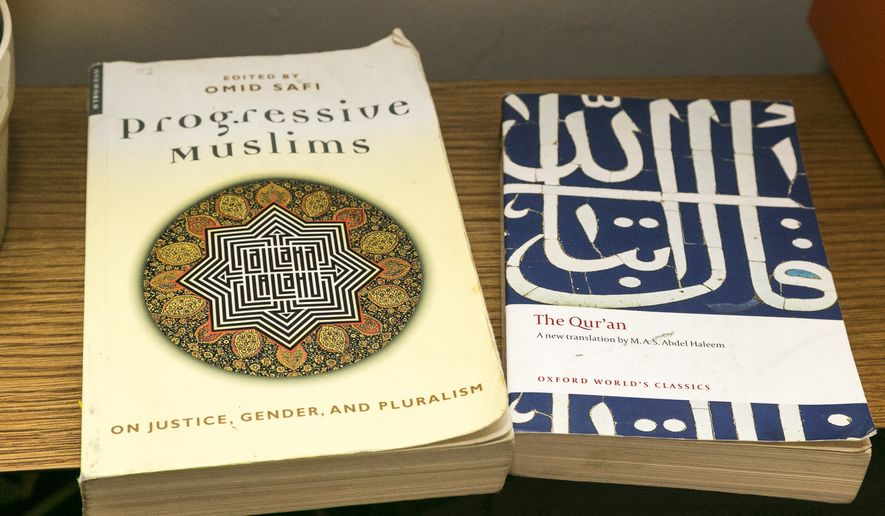 The Quran (right) is the Muslim holy book. (AP Photo/Damian Dovarganes)