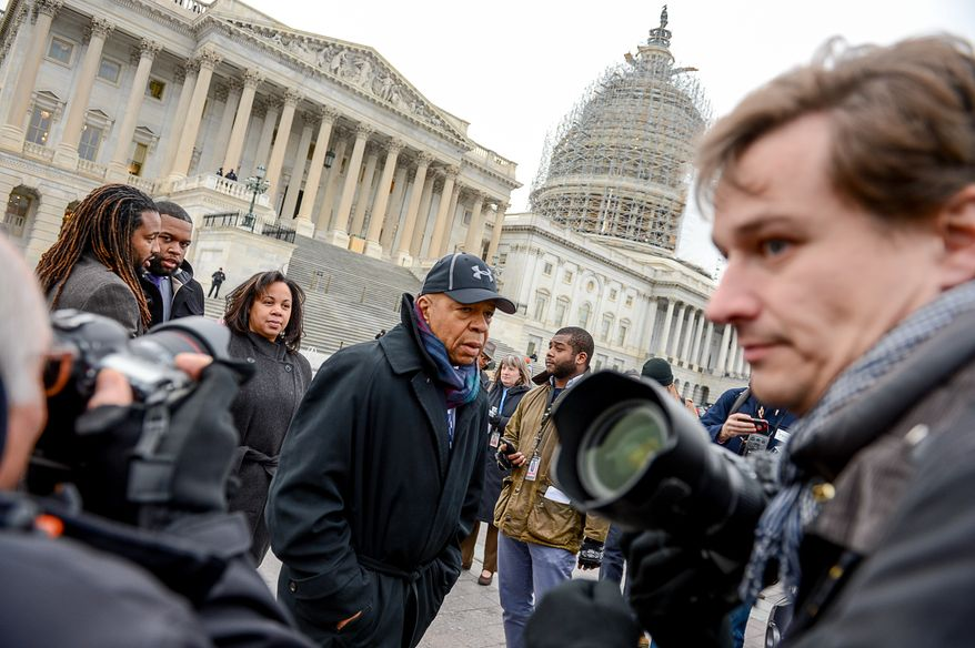Rep. Elijah Cummings (D-Md.), center, joins African American Congressional staffers as they hold a protest on the House steps of the U.S. Capitol Building to protest the Eric Garner and Mike Brown grand jury decisions, Washington, D.C., Thursday, December 11, 2014. (Andrew Harnik/The Washington Times)