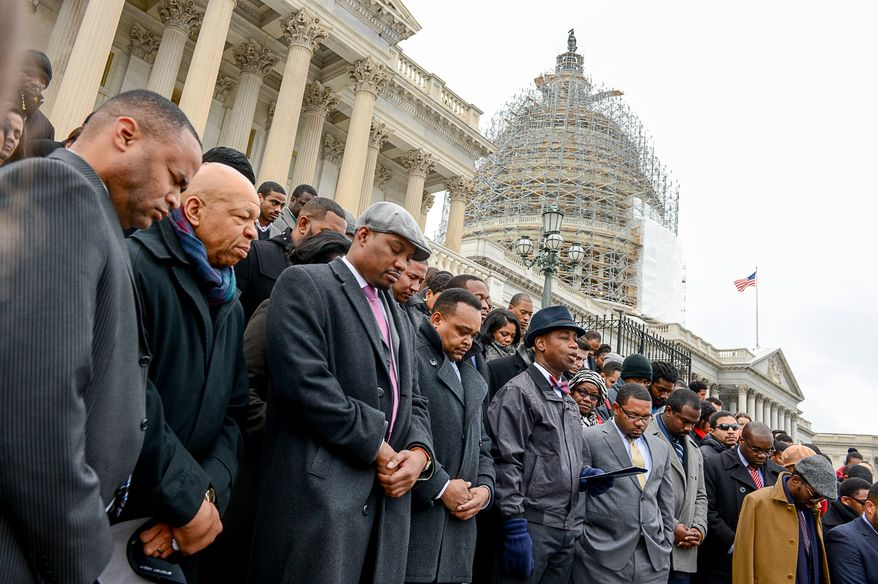 Rep. Elijah Cummings (D-Md.), second from left, joins African American Congressional staffers as they hold a protest on the House steps of the U.S. Capitol Building to protest the Eric Garner and Mike Brown grand jury decisions, Washington, D.C., Thursday, December 11, 2014. (Andrew Harnik/The Washington Times)