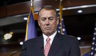 House Speaker John Boehner of Ohio pauses while holding what may be his last news conference of the 113th Congress, though critical legislation is still pending, Thursday, Dec. 11, 2014, on Capitol Hill in Washington. (AP Photo/J. Scott Applewhite)
