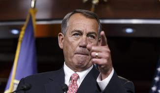 House Speaker John Boehner of Ohio holds what may be his last news conference of the 113th Congress Thursday, Dec. 11, 2014, on Capitol Hill in Washington. (AP Photo/J. Scott Applewhite)