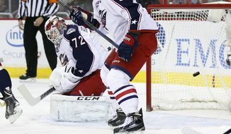 Columbus Blue Jackets goalie Sergei Bobrovsky (72), from Russia, lets a shot by Washington Capitals right wing Eric Fehr get past him for a goal in the first period of an NHL hockey game, Thursday, Dec. 11, 2014, in Washington. (AP Photo/Alex Brandon)