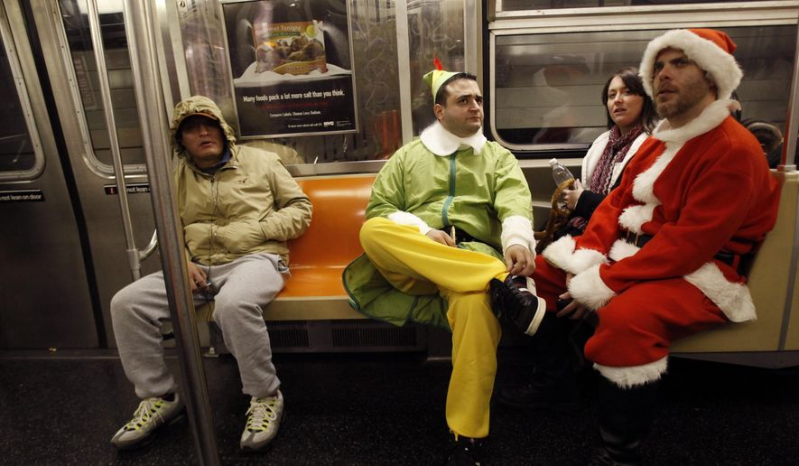FILE - In this Dec. 11, 2010 file photo, John Paul, center, and Michael Smallwood, ride the subway as they participate in SantaCon, Saturday, Dec. 11, 2010 in New York.   Organizers of the bar crawl have retained Norman Siegel, a civil rights lawyer, amid growing opposition to the annual event from New York City neighborhoods. Siegel says the Santa-clad participants have a right to express themselves as long as they don't break the law. (AP Photo/Mary Altaffer)