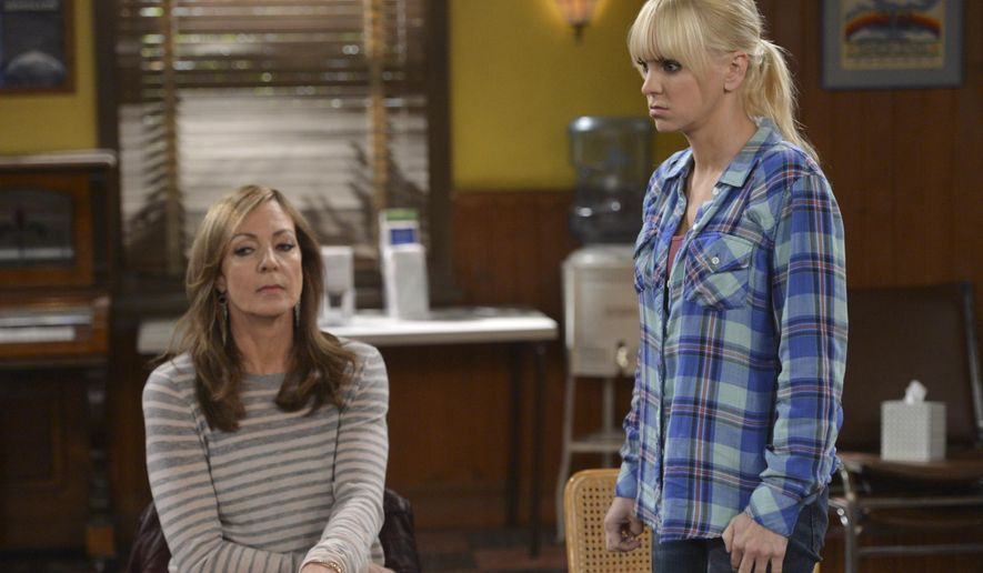 """In this image released by CBS, Allison Janney, left, and Anna Faris appear in a scene from """"Mom."""" Janney was nominated for a Golden Globe for best supporting actress in a TV movie or mini-series for her role on Thursday, Dec. 11, 2014. The 72nd annual Golden Globe awards will air on NBC on Sunday, Jan. 11. (AP Photo/CBS, Darren Michaels)"""