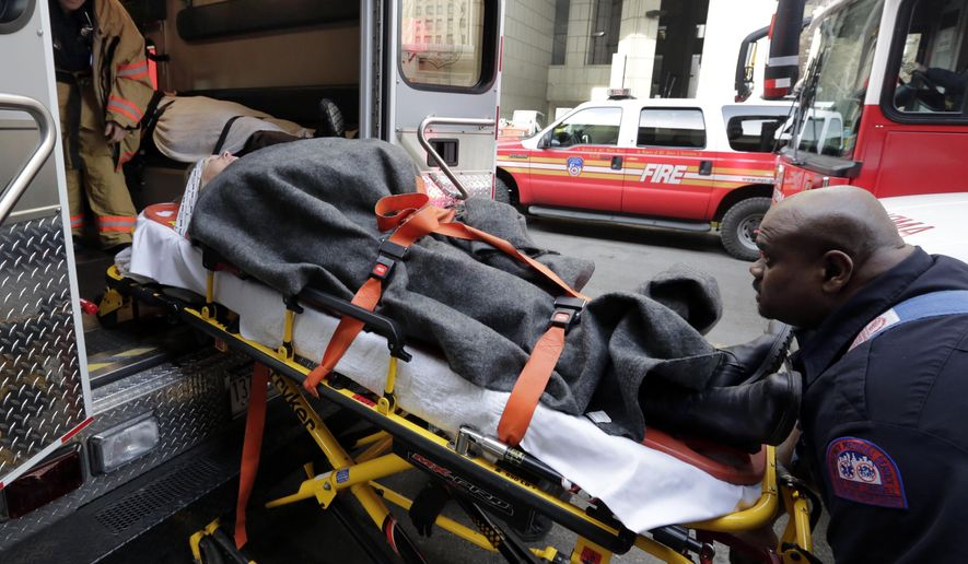FILE - In this Jan. 9, 2013 file photo, an injured passenger of a New Jersey ferry is loaded into an ambulance, in New York. Nearly 20 percent of U.S. consumers _42.9 million people _ have unpaid medical debts, according to a new report released Thursday, Dec. 11, 2014 by the Consumer Financial Protection Bureau. The findings suggest that many Americans lack the financial resources to pay for health emergencies _ and that the notices from hospitals and insurance companies about the cost of treatment are confusing and baffling. (AP Photo/Richard Drew, File)