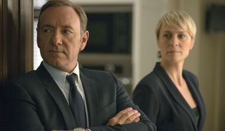 "This image released by Netflix shows Kevin Spacey as Francis Underwood, left, and Robin Wright as Clair Underwood in a scene from ""House of Cards."" The show was nominated for a Golden Globe for best drama series on Thursday, Dec. 11, 2014. The 72nd annual Golden Globe awards will air on NBC on Sunday, Jan. 11.  (AP Photo/Netflix, Nathaniel E. Bell)"