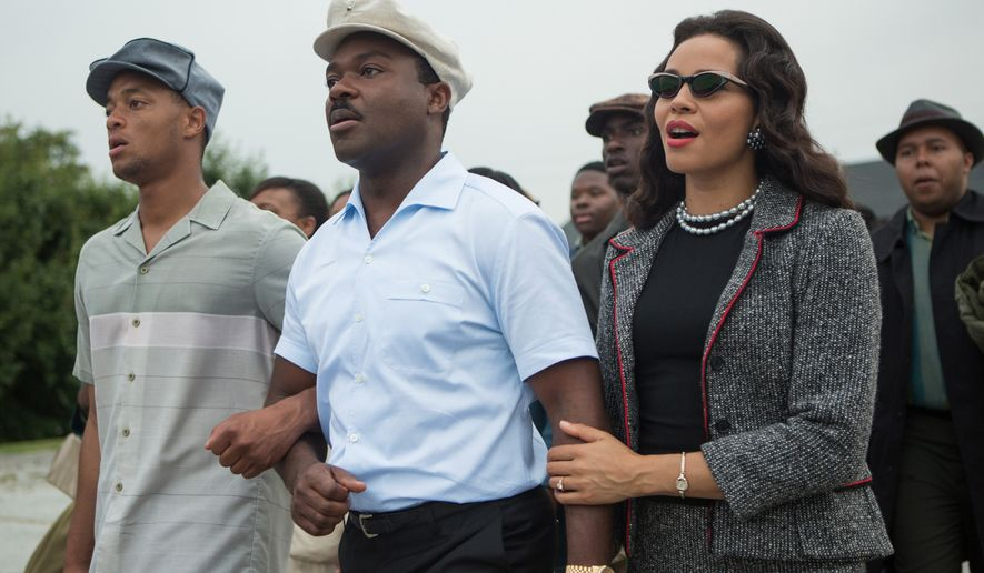 "This photo released by Paramount Pictures shows, David Oyelowo, center, as Martin Luther King, Jr. and Carmen Ejogo, right, as Coretta Scott King in the film, ""Selma.""  The film was nominated for a Golden Globe for best drama on Thursday, Dec. 11, 2014. The 72nd annual Golden Globe awards will air on NBC on Sunday, Jan. 11. (AP Photo/Paramount Pictures, Atsushi Nishijima)"