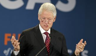 Former President Bill Clinton addresses leaders from across the hemisphere during the closing session at the Latin America summit in Coral Gables, Fla. on Thursday, Dec. 11, 2014. The event included business leaders like Mexican billionaire Carlos Slim, The Nature Conservancy CEO Mark Tercek and Alfonso Quinonez, of the Organization of American States. (AP Photo/Alan Diaz)