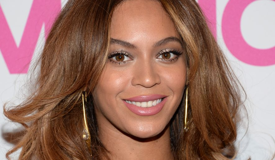 Beyonce attends the 2014 Billboard Women in Music luncheon at Cipriani Wall Street on Friday, Dec. 12, 2014, in New York. (Photo by Evan Agostini/Invision/AP)