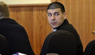 Aaron Hernandez, a former New England Patriots NFL football player, looks back towards the gallery during the pre-trial motion hearing in the Superior Court in Fall River, Mass., Friday, Dec. 12, 2014.  Judge Susan Garsh says prosecutors in the murder case against Hernandez may not tell jurors about two other killings with which the he is charged. Hernandez has pleaded not guilty to murder in the 2013 killing of Odin Lloyd, a semi-professional football player who was dating the sister of Hernandez's fiancee. He has also pleaded not guilty to the fatal shootings of two men in 2012 after an encounter at a Boston nightclub.  (AP Photo/The Boston Globe, Robert E. Klein, Pool)