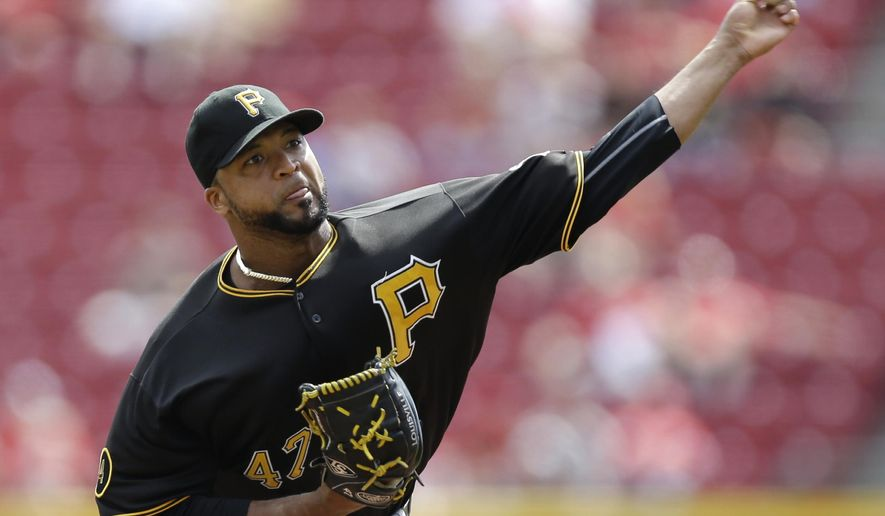 FILE - In this Sept. 27, 2014, file photo, Pittsburgh Pirates starting pitcher Francisco Liriano throws against the Cincinnati Reds in the first inning of a baseball game in Cincinnati. Liriano and the Pirates have finalized a $39 million, three-year contract, in a deal, announced Friday, Dec. 12, 2014,   (AP Photo/Al Behrman, File)