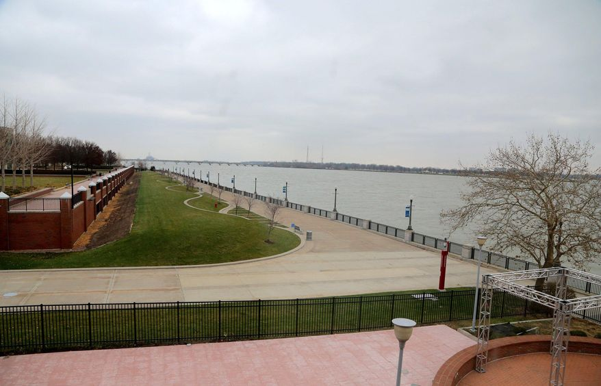 ADVANCE FOR RELEASE MONDAY, DEC. 15, 2014, AND THEREAFTER- This Nov. 25, 2014, photo shows the view of the Detroit River and the riverwalk from one of the hotel suites at the Roberts Riverwalk Hotel in Detroit. Michael Roberts had already enjoyed a long career in his native St. Louis before he bought the defunct Omni Hotel on Detroit's east riverfront in 2010. (AP Photo/Detroit Free Press, Jessica J. Trevino)  DETROIT NEWS OUT;  NO SALES
