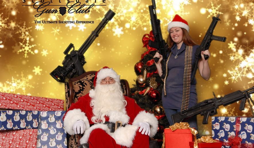 This undated image provided by the Scottsdale Gun Club shows a woman posing with Santa Claus and several guns at the Scottsdale, Ariz. club. Ron Kennedy, general manager of the gun club, says the business got the idea for the photo op last year when a club member happened to come in dressed as Santa and other members wanted their picture taken while they were holding their guns. He says people have used the photos for Christmas cards and Facebook posts. (AP Photo/Scottsdale Gun Club, Gordon Murray) **FILE**