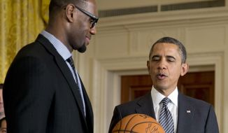 President Barack Obama accepts a signed basketball from Miami Heat forward LeBron James as he welcomes the the NBA basketball champion Miami Heat, to the East Room of the White House, Monday, Jan. 28, 2013, in Washington. (AP Photo/Carolyn Kaster) **FILE**
