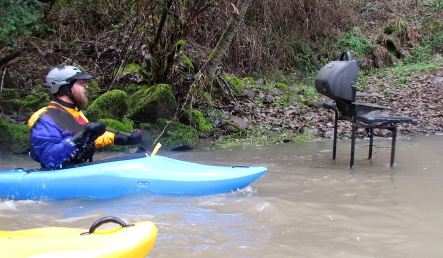 ADVANCE FOR WEEKEND EDITIONS, DEC. 13-14 - In this photo taken on Nov. 16, 2014, kayakers paddle Thomas Creek, a tributary of the South Santiam River located southwest of Stayton, Ore. The scenic stream is home to Class II and III rapids. (AP Photo/Statesman-Journal, Zach Urness)