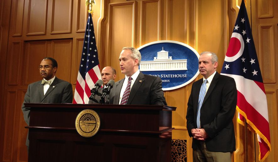 Senate President Keith Faber, R-Celina, describes a bipartisan agreement on a plan to overhaul how Ohio draws its legislative lines at a news conference early Friday morning Dec. 12, 2014 at the Ohio Statehouse in Columbus. From left: Rep. Vernon Sykes, D-Akron; Senate Minority Leader Joe Schiavoni, D-Boardman; Senate President Keith Faber, R-Celina  and Rep. Matt Huffman, R-Lima. (AP Photo/Ann Sanner)