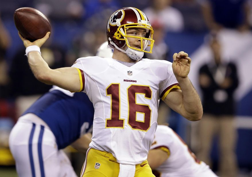 FILE - In this Nov. 30, 2014, file photo, Washington Redskins quarterback Colt McCoy throws a pass against the Indianapolis Colts during the second half of an NFL football game in Indianapolis. McCoy took part in the full Redskins practice Friday, Dec. 12, 2014, getting all of the first-team snaps to stay on pace to start Sunday's game against the New York Giants.  (AP Photo/Darron Cummings, File)