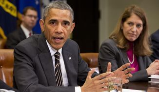 President Barack Obama sits next to Health and Human Services Secretary Sylvia Burwell as he speaks about Ebola during a meeting with his national security and public health teams, Friday, Dec. 12, 2014, in the Roosevelt Room of the White House in Washington. (AP Photo/Jacquelyn Martin)
