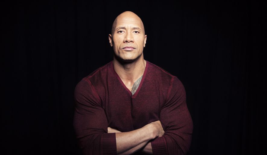 "In this Dec. 8, 2014, photo, Dwayne ""The Rock"" Johnson poses in New York to promote his TNT reality series ""Wake Up Call,"" premiering Friday at 9 p.m. ET. (Photo by Taylor Jewell/Invision/AP) ** FILE **"
