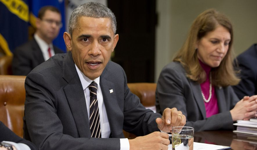 President Barack Obama sits next to Health and Human Services Secretary Sylvia Burwell, as he speaks about Ebola during a meeting with his national security and public health teams on Dec. 12, 2014, in the Roosevelt Room of the White House in Washington. (Associated Press) **FILE**