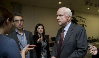 Sen. John McCain, R-Ariz., listens to questions from reporters on Capitol Hill in Washington, Friday, Dec. 12, 2014. (AP Photo/Manuel Balce Ceneta) ** FILE **